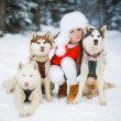 Portrait of a beautiful woman with Siberian huskies - Husky. — Stock Photo #61976105