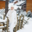 Portrait of a beautiful woman at a ski resort in winter. — Stock Photo #61976111