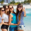 Beautiful girls are photographed on a tropical resort on the background of the beach and ocean. — Stock Photo #62952751