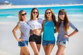 Beautiful girls are photographed on a tropical resort on the background of the beach and ocean. — Stock Photo