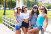Beautiful girls are photographed on a tropical resort on a background of green nature. — Stock Photo