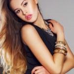 Girl model posing in Studio on gray background — Stock Photo #63543275