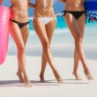 Three beautiful young women on the beach in a bikini. — Stock Photo #63751701