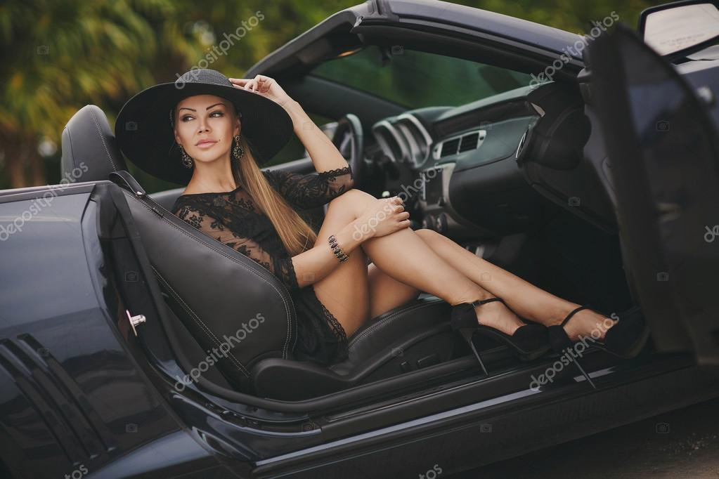 Portrait Of A Young Lady In The Car In A Big Black Hat