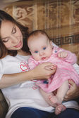 Happy mother with newborn baby girl in her arms. — Stock Photo