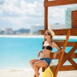 Portrait of a beautiful woman on a tropical beach. — Stock Photo #67947173