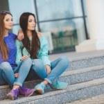 Urban portrait of two beautiful girlfriends. — Stock Photo #69815587