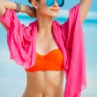 Attractive young woman with red pareo for the beach — Stock Photo #72230173