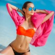 Attractive young woman with red pareo for the beach — Stock Photo #72230183