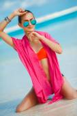 Attractive young woman with red pareo for the beach — Stockfoto