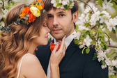 The bride and groom - photo in a flowery Park in the spring. — Stock Photo