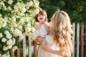 Portrait of happy woman with a small daughter in the village in the spring — Stock Photo
