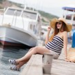 Pregnant beautiful woman on the pier at the sea — Stock Photo #77454696