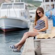 Pregnant beautiful woman on the pier at the sea — Stock Photo #77455160