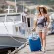 Pregnant beautiful woman on the pier at the sea — Foto de Stock   #77455362