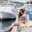 Pregnant beautiful woman on the pier at the sea — Stockfoto #77455482