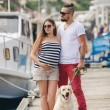 Young couple on a walk in the Harbor with a white Labrador — Stockfoto #77865916