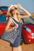 Beautiful blonde and red small car. — Stock Photo