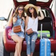 Selfie two girlfriends in the trunk of a car — Stock Photo #82509962