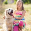 Portrait of a Girl with her beautiful dog outdoors. — 图库照片 #84462294