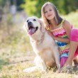 Portrait of a Girl with her beautiful dog outdoors. — 图库照片 #84462296
