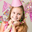 Funny girl in birthday cap — Stock Photo #68935295
