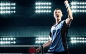 Young handsome sportsman celebrating flawless victory in table tennis — Stock Photo