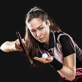 Young pretty sporty girl playing table tennis on black background — Stock Photo