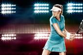 Beautiful sport woman tennis player with a racket in blue costume — Stock Photo