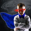 Superhero school boy — Stock Photo #68227827