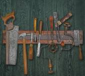 Vintage woodworking tools on a wall — Stock Photo