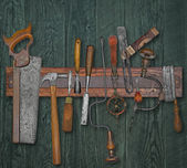 Vintage woodworking tools on a wall — Stok fotoğraf