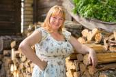 Portrait of a women near woodpile — Stock Photo