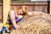 Woman near a haystack — Stock Photo
