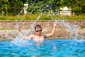 Happy boy in a swimming pool — Stock Photo