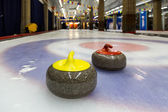 Curling stones on an indoor rink — Stock Photo
