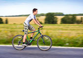 Teenager riding a bike — Stock Photo