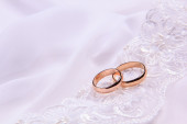 Two  weddings rings on white  fabric — Stock Photo