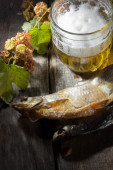 Mug of beer and dried fish — Stock Photo