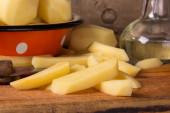 Raw potatoes in a vintage enamel bowl  — 图库照片