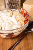 Vegetable salad with grated cheese — Stock Photo