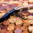 Corkscrew on wine stoppers — Stock Photo #64643551