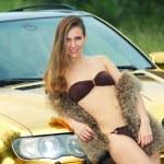 Sexy lady in bikini near golden car. — Stock Photo #52547543