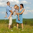 Family of four having fun on top of hill — Stock Photo #52594723