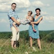 Family of four having fun on top of hill — Stock Photo #52594727