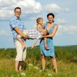 Family of four having fun on top of hill — Stock Photo #52594729