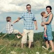 Family of four having fun on top of hill — Stock Photo #52594741