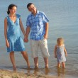 Young family having fun on the beach — Stock Photo #52594771