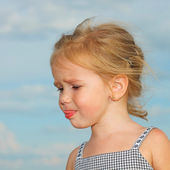 Sad little girl with blond hair — Stock Photo