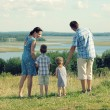 Happy family on top of hill — Stock Photo #55388935